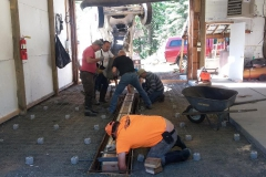 Pouring the concrete floor in the groomer shed