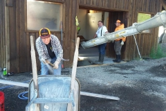 Pouring a concrete floor in the warming shelter